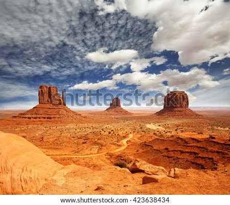 view of monument valley under a cloudy sky - stock photo
