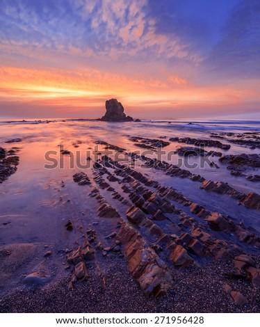 View of moody sunset on Widemouth Beach, Cornwall, UK - stock photo