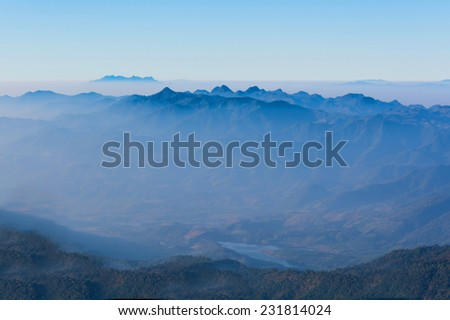 View of Morning Mist at Tropical Mountain Range, Chiang Mai, Thailand - stock photo