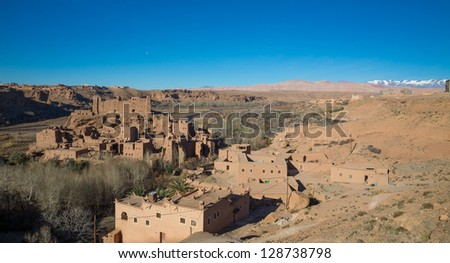 view of Morocco Kasbah over blue sky and atlas mountains - stock photo