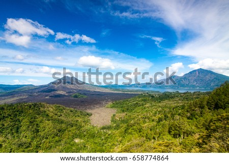 view of mount Batur and Agung from Kintamani viewing point in Bali Island Indonesia with blue sky and some cloud