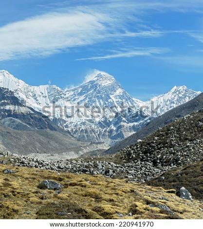 View of Mount Everest (8848 m) and Lhotse (8516 m) from the Ngozumba Tsho (the fifth Gokyo lake) - Nepal, Himalayas - stock photo