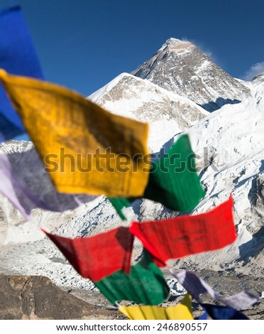 view of Mount Everest with buddhist prayer flags from Kala Patthar, way to Everest base camp, Nepal