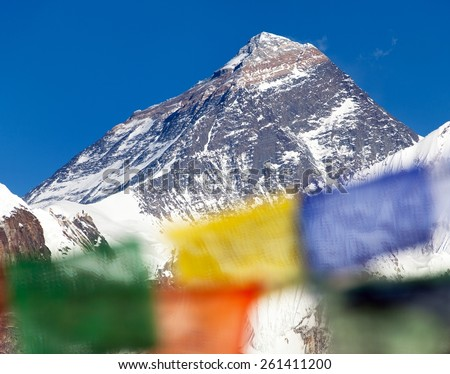 view of Mount Everest with buddhist prayer flags from Renjo La pass - Nepal - stock photo