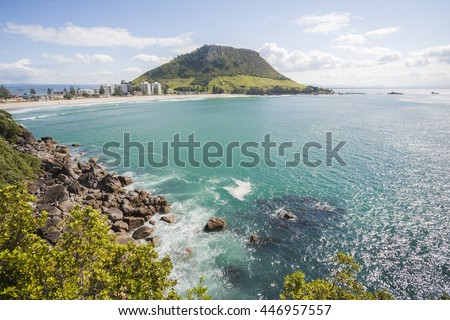 View of Mount Maunganui, Bay of Plenty, New Zealand, from Moturiki Island. The Mount, also known as Mauao, is an extinct volcano.