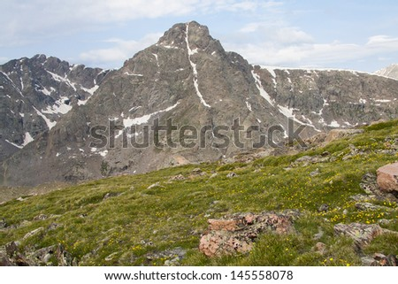 View of Mount of the Holy Cross from Notch mountain, near Vail in the Colorado Rockies.  Snow in the couloir forms a cross during the early Summer. - stock photo