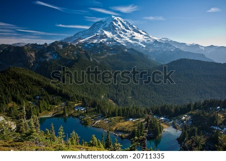 View of Mount Rainier with a lake in the foreground - stock photo