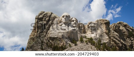 view of Mount Rushmore National Monument on a spring morning with some clouds and sunshine