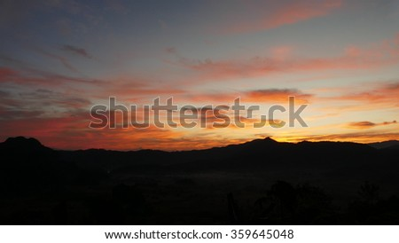 view of mountain, cloud and sky at twilight