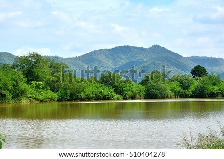 View of mountain forest tree river natural landscape with sunny.