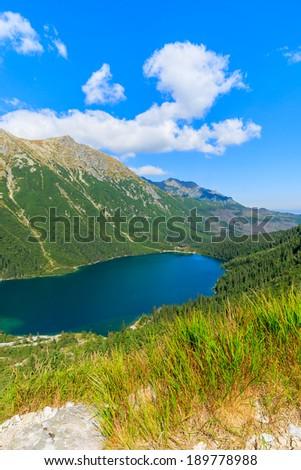 View of mountain lake Morskie Oko from trail to Czarny Staw, Tatra Mountains, Poland - stock photo