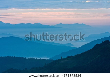 View of mountains in early morning rays of light, in Himalayas, Langtang National Park, Nepal - stock photo