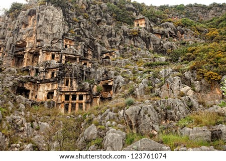 View of mountainside with rock cut tombs at Myra Turkey - stock photo
