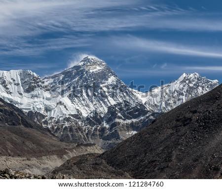 View of Mt. Everest (8848 m) and Lhotse (8516 m) from the Ngozumba Tsho ( the fifth Gokyo lake ) - Nepal, Himalayas - stock photo