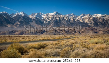 View of Mt Whitney with a curved empty road - stock photo