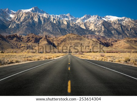 View of Mt Whitney with a straight empty road - stock photo