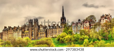 View of New College from Princes Street Gardens in Edinburgh - stock photo