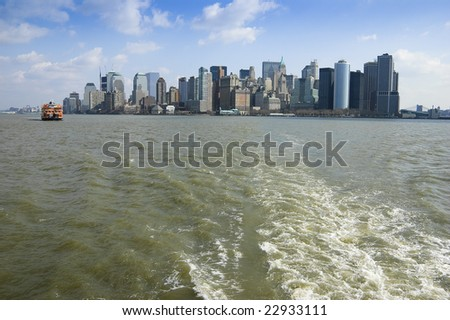View of New York City from ferryboat to Ellis Island