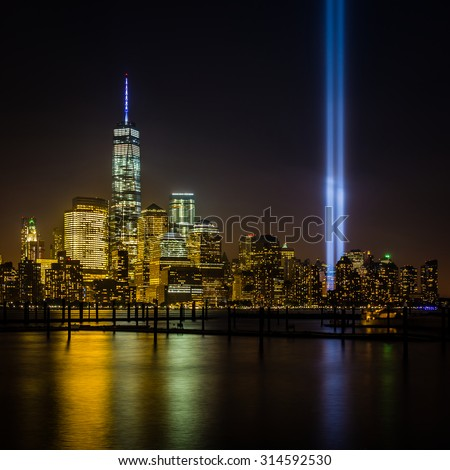 View of New York City from New Jersey - cityscape including the Freedom Tower with Tribute in Light - stock photo