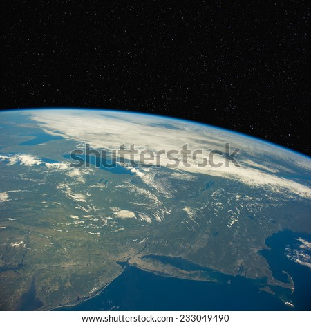 View of  New York state from space with stars above. Elements of this image furnished by NASA. - stock photo