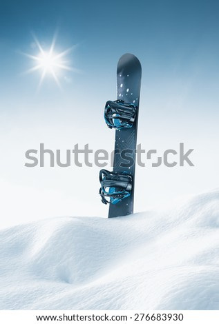 view of nice blue snowboard in winter environment - stock photo