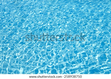 View of nice blue swimming pool water surface - stock photo