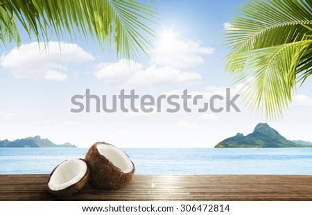 view of nice coconut,  palms, blue ocean  and tropical islands in distance  - stock photo