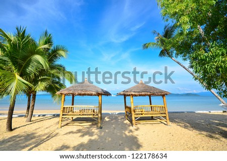 view of nice double bamboo hut on tropical beach