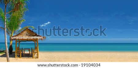 View of nice empty sandy beach with some tropical hut. Banner, lots of copy space. - stock photo