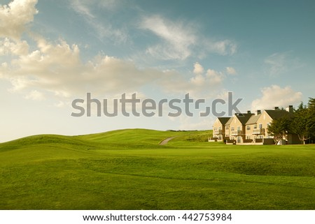 View of nice green valley and cozy house in summer environment - stock photo