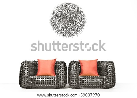 View of nice modern twiggen chairs on white back - stock photo