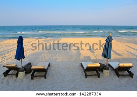 View of nice tropical empty  beach with umbrella and beach - stock photo