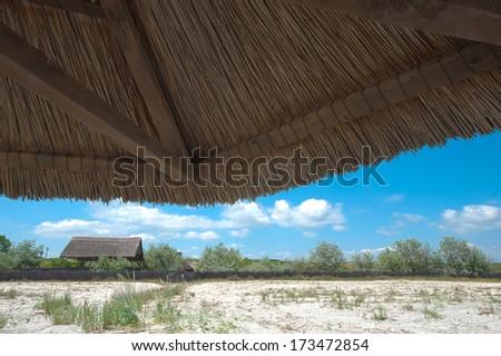 View of nice tropical empty sandy beach with umbrella - stock photo