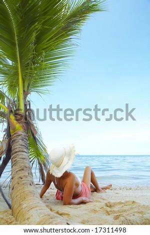View of nice woman having fun on tropical beach - stock photo