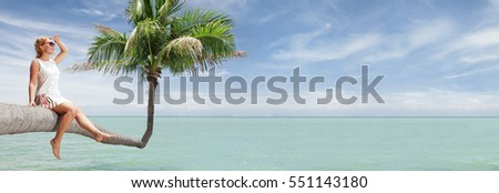 view of nice young lady sitting on palm  on tropical beach. banner.