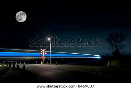View of night train lights and moon. Night shot. Space for text. - stock photo