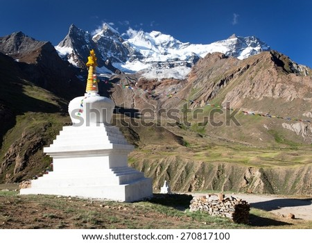 view of Nun Kun Range with buddhist prayer flags - Great himalaya mountains - Zanskar range - Ladakh - Jammu and Kashmir - India  - stock photo