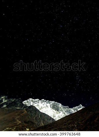 View of Nuptse wall in the Moonlight - Everest region, Nepal, Himalayas - stock photo