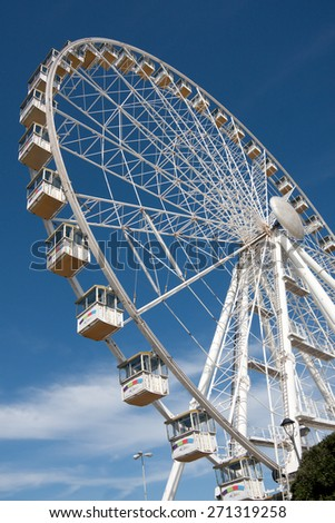 View of Observation Wheel Against the Blue Sky With Clouds in Rimini, Italy, 29 of march, 2015