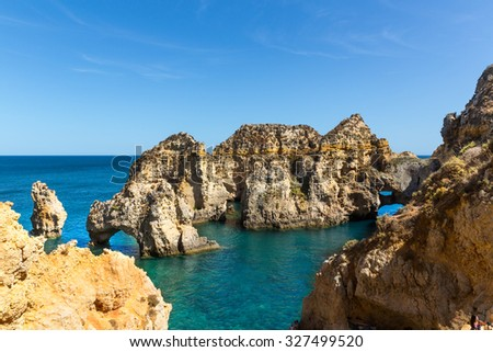 View of ocean shore with cliffs, Algarve, Portugal - stock photo