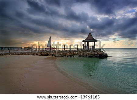 view of oceanfront gazebo at dusk - stock photo