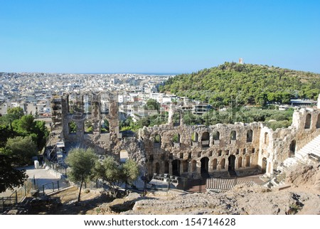 View of Odeon theater and Mouseion hill from Acropolis, Athens, Greece  - stock photo