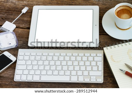 view of  office workplace - keyboard with tablet, copy space on blank screen - stock photo