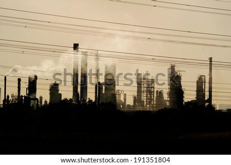 view of oil crude refinery against the sunlight - stock photo