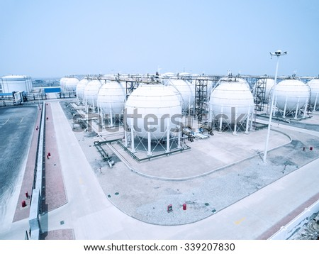 view of oil depot with containers in blue sky - stock photo