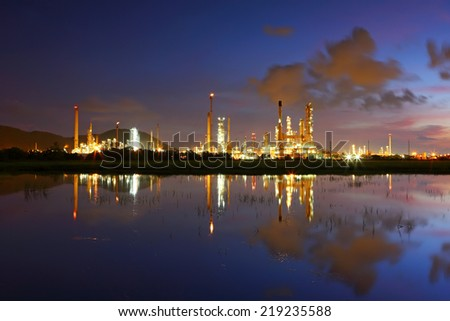 View of oil refinery factory at sunrise - stock photo
