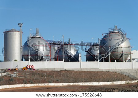 View of oil refinery of a sky background  - stock photo