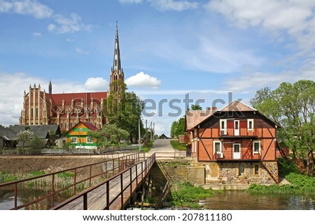 View of old and famous  belarussian town Gervyaty with catholic church and water mill - stock photo