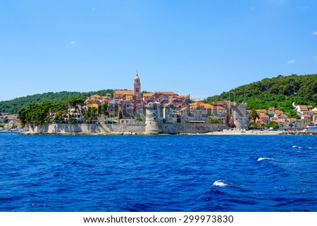 View of old city from the sea, with city walls and towers, the cathedral, in Korcula, Croatia - stock photo