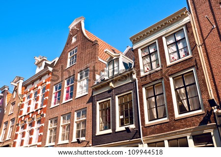 View of old converted warehouses, Amsterdam, with typical Dutch gables. - stock photo